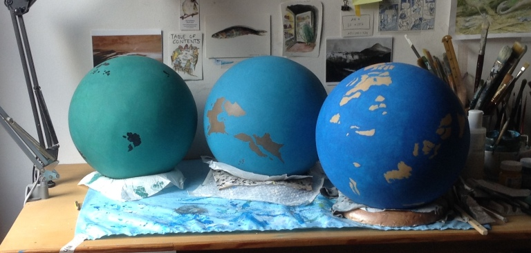 three globes cropped